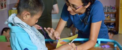 An Occupational Therapy intern gains work experience by helping treat a disabled child in Cambodia.